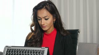 Frustrated unhappy ethnic businesswoman using laptop touchscreen