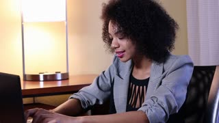 Frustration while working - African American businesswoman in office