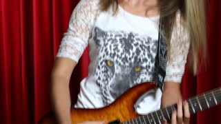 Girl playing electric guitar close up on hands and guitar body