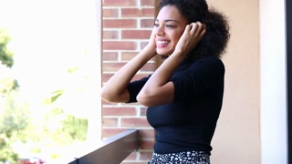 Happy attractive young ethnic woman with afro dancing