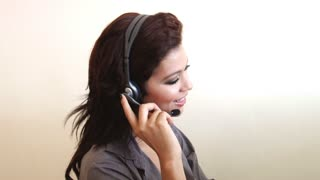 Happy customer service worker at call center