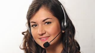 Happy helpful customer service worker talking into headset