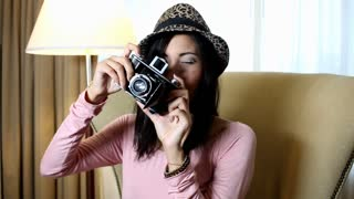 Hipster girl with old camera having fun