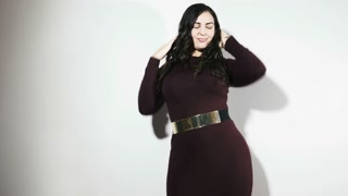 Plus size model woman feeling positive in dress - cinematic color grade