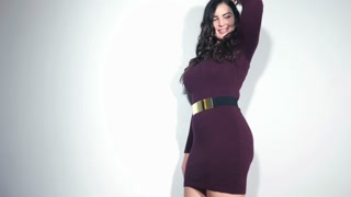 Plus Size model woman feeling positive in dress