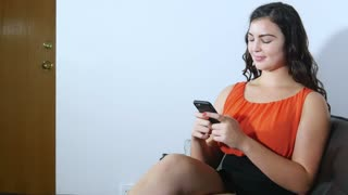 Plus size woman sending text message on smart phone - positive