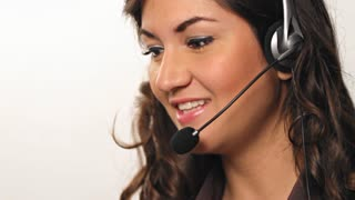 Pretty hispanic Customer service worker talking into headset
