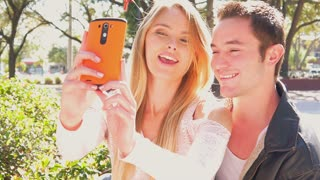 Selfie in love with kiss - young romantic couple