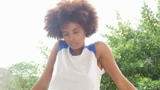Serious African American hipster girl outdoors portrait