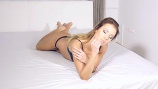 Sexy bikini lingerie model woman having fun on bed