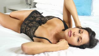Sexy black lingerie ethnic girl on bed
