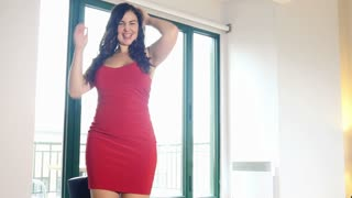 Sexy dancing in red dress plus size model woman