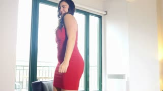 Sexy dancing plus model girl in red dress