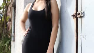 Sexy fashion woman in black dress pan up