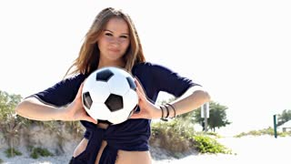 Sexy german girl with football at the beach