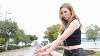Sexy hipster girl on railroad tracks with electric guitar