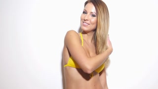Sexy hot bikini girl slow dance on white background