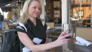 Slow motion woman at cafe cheers toasting with wine glass