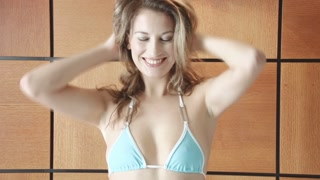Smiling sexy bikini girl