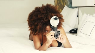 Summer time fun ethnic African American hipster woman with vintage camera