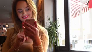 Pretty blonde hip girl at cafe in European city