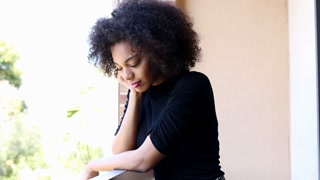 Young African American woman waiting and sad
