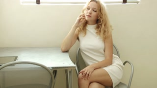 Young blonde woman - student looking pensive and sad