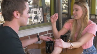 Young couple in love at cafe - warm film