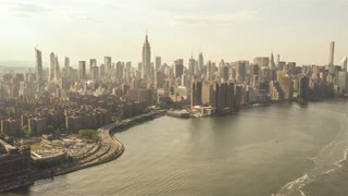 East River | New York City | 4K Aerial clip of the East River in NYC filmed from a helicopter.