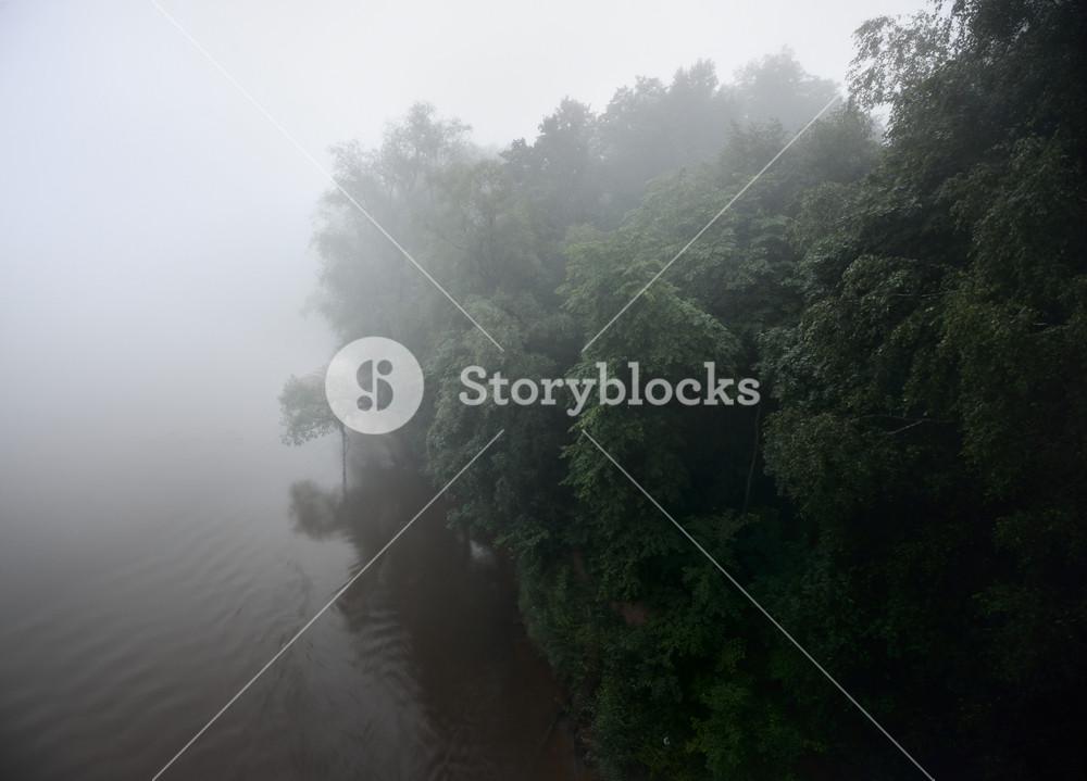 River Scene In Strong Fog