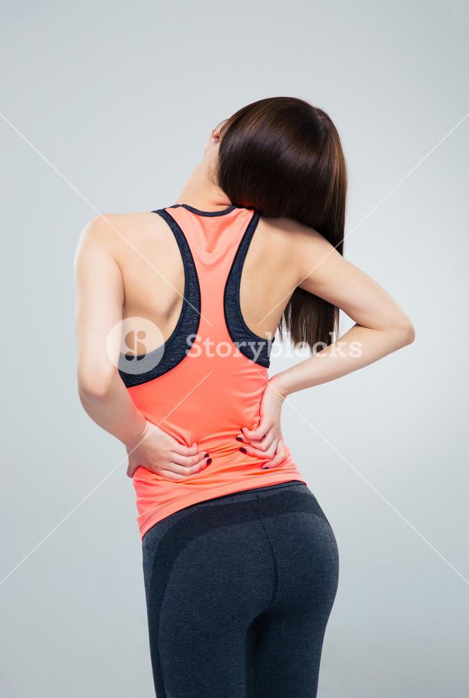Fitness woman having back pain