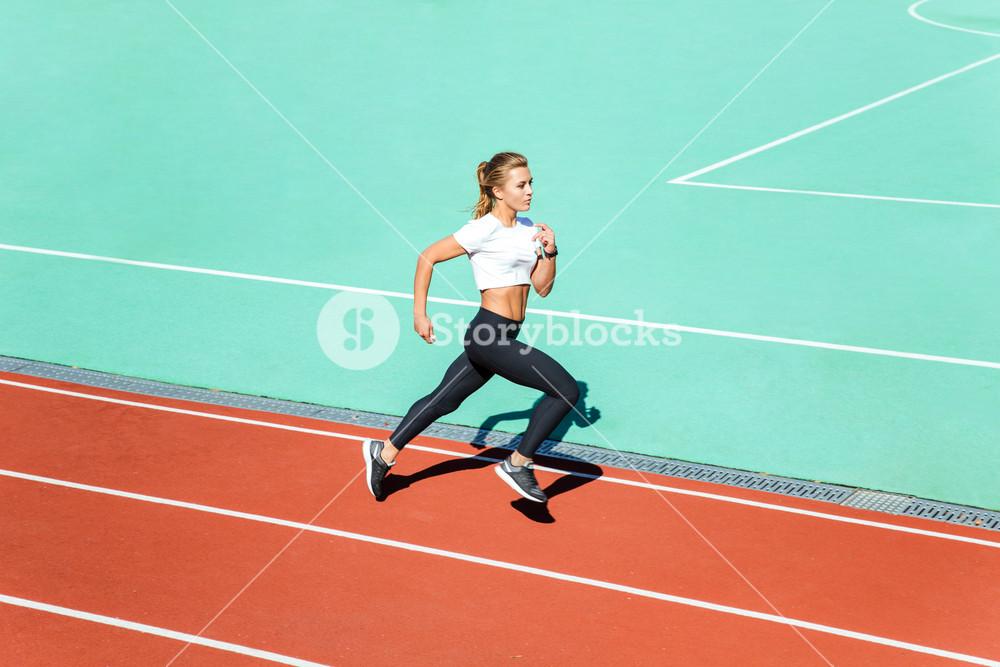 Fitness woman running at stadium