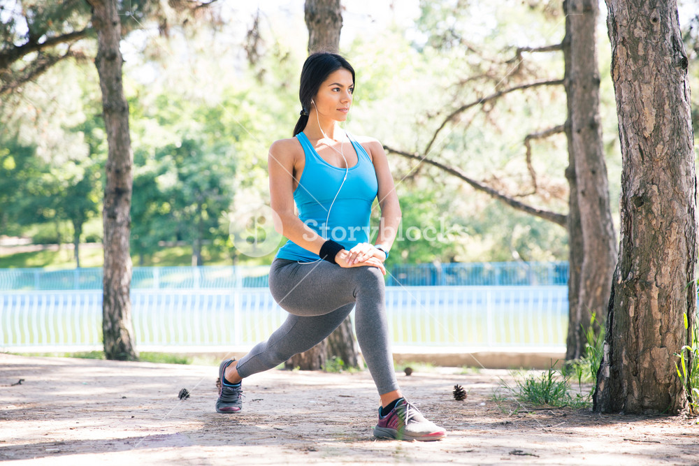 Sporty woman doing stretching exercise