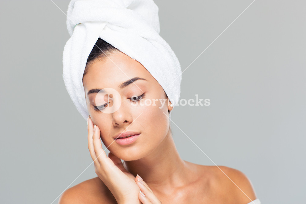Portrait of a beautiful woman with towel on head