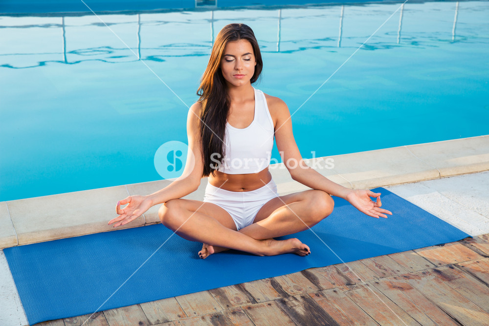 Portrait of a young girl meditating
