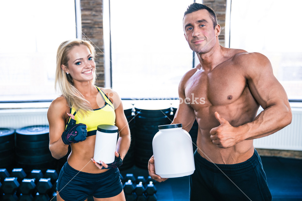 Man and woman holding container with sports nutrition