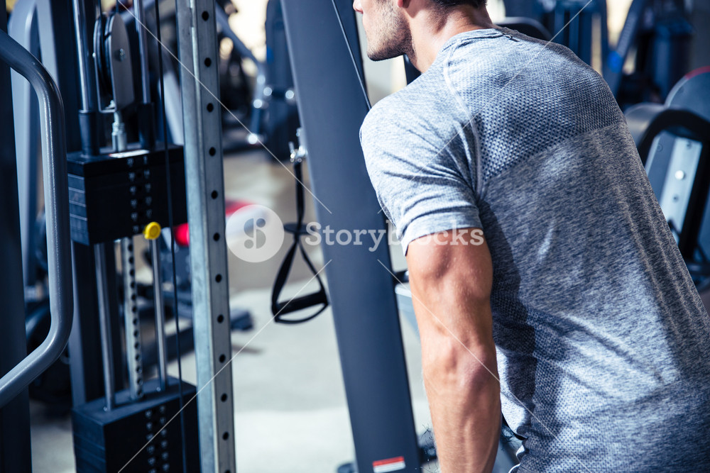 Man workout in fitness gym