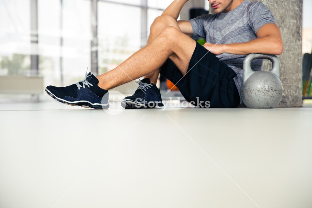Man sitting on the floor at gym