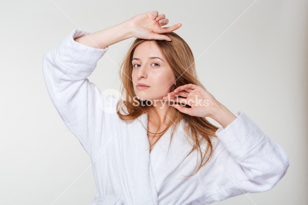 Beauty portrait of a young woman in bathrobe