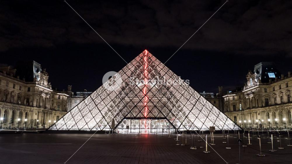 Illuminated glass pyramid at the louvre