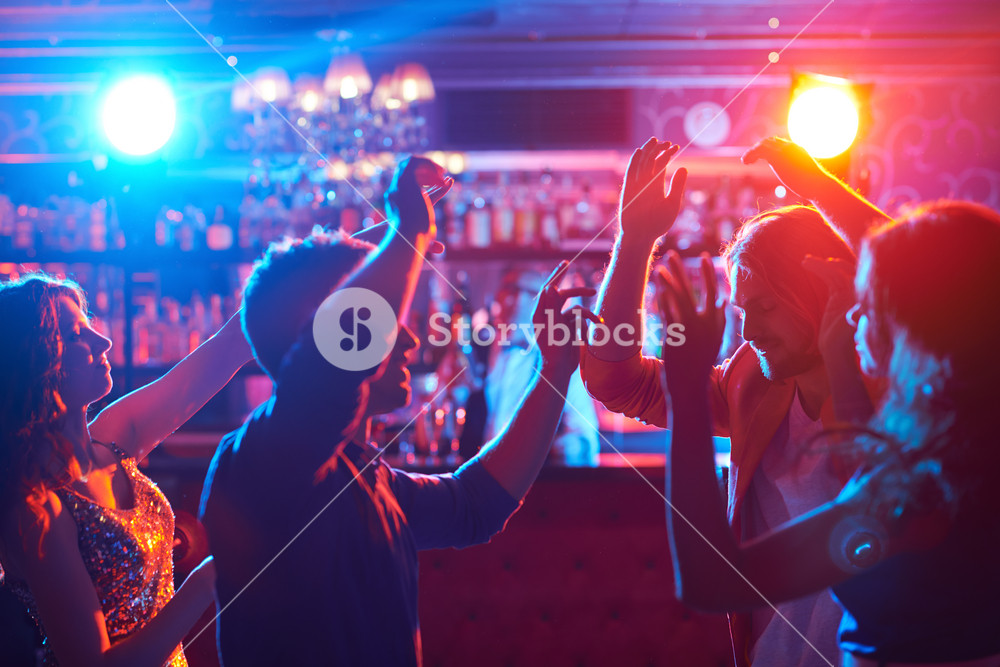 Portrait Of Happy Friends Dancing At Party