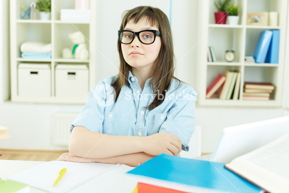 Portrait Of An Excellent Female Student Sitting At Desk