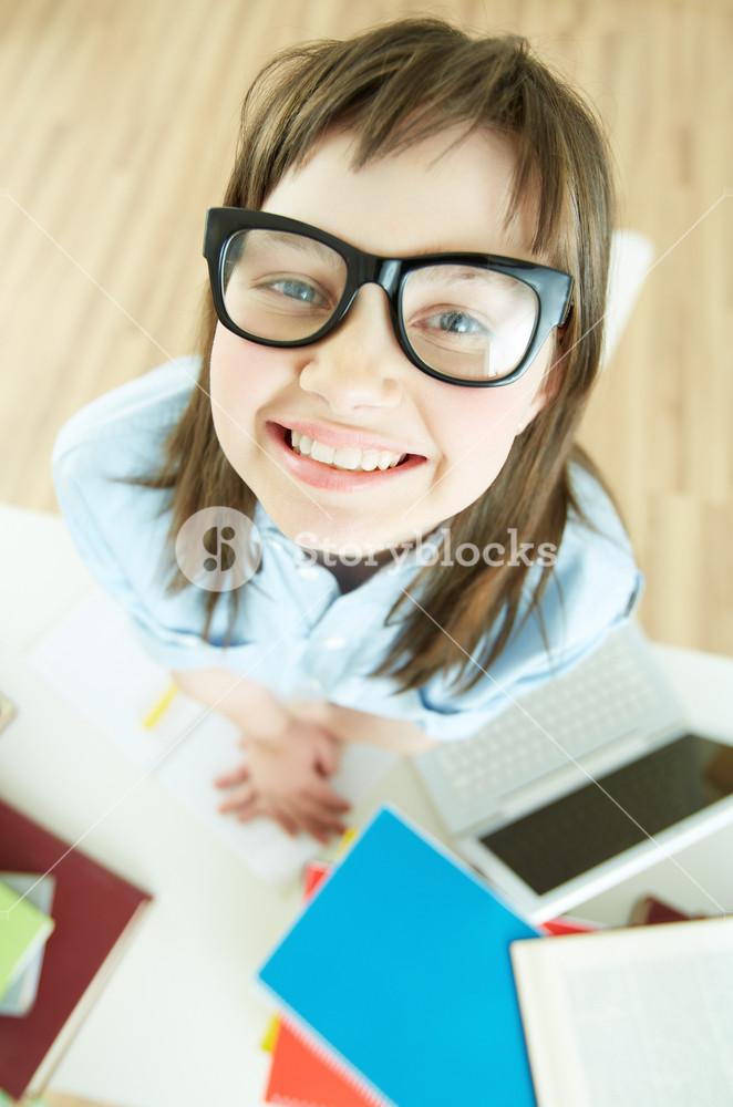 Vertical Portrait Of A Funny School Girl Wearing Nerdy Eyeglasses