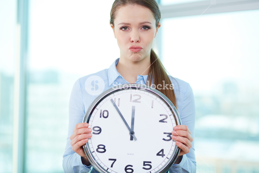 Conceptual Portrait Of A Business Lady With Clock Being Short Of Time