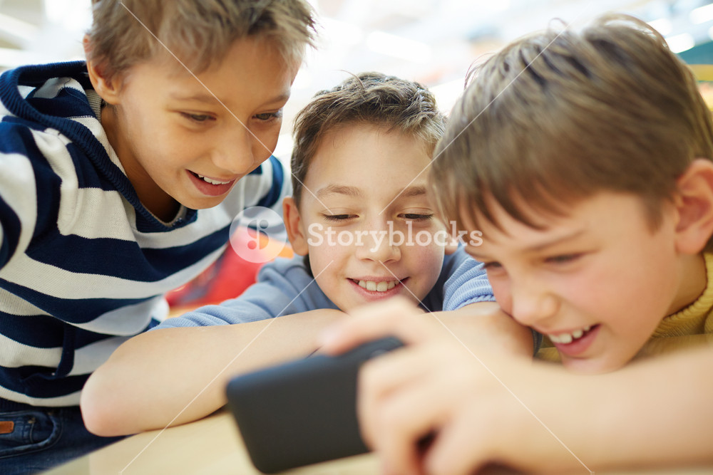 Boys Using A New Smartphone