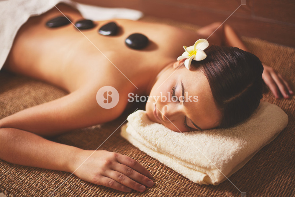 Portrait Of Young Female Lying In Spa Salon During Beauty Procedure