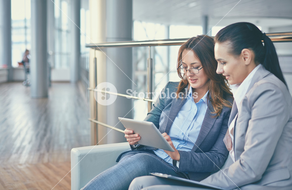Image Of Two Elegant Businesswomen Discussing Computer Project