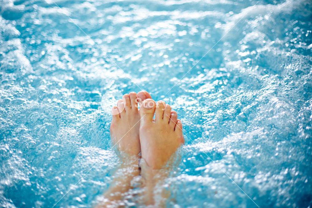 Close-up Of Female Legs In Hot Tub