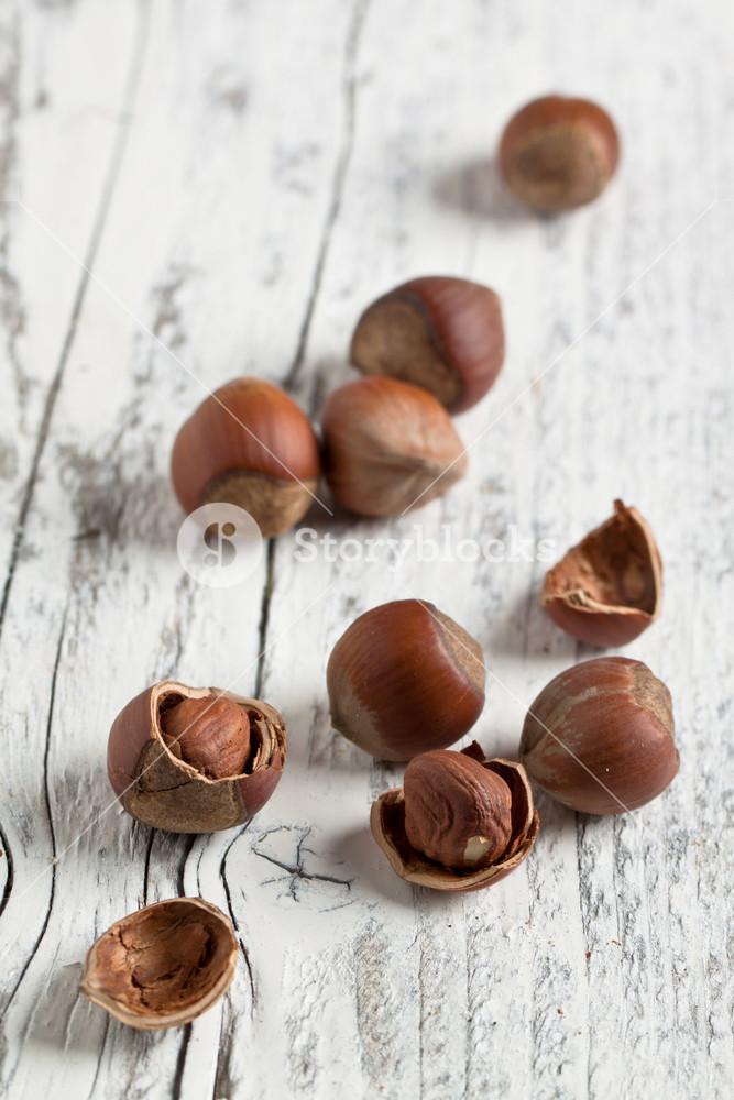 Hazelnuts On White Wood