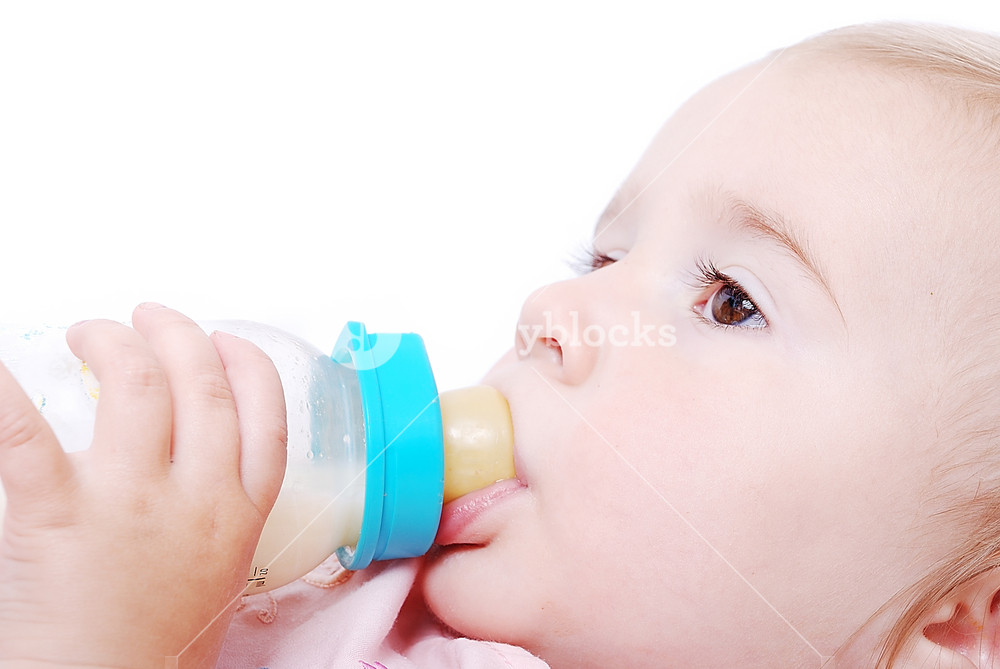 Adorable baby with milk bottle